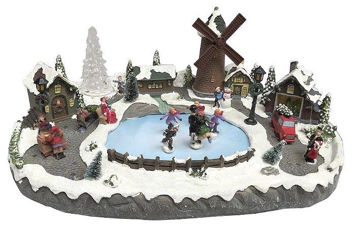 Vila com moinho e patinação