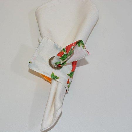 porta guardanapo de tecido fundo branco com arranjos de Natal
