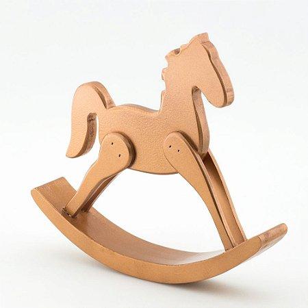Cavalinho de balanço cobre