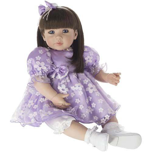 Bebê Reborn Laura Doll Belinda com Vestidinho Floral Roxo
