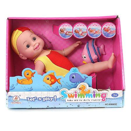 Boneca Bebê Que Nada De Frente E Costa