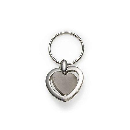 Chaveiro metal giratório formato coração,possui chapa central coração. Código: SK 5018