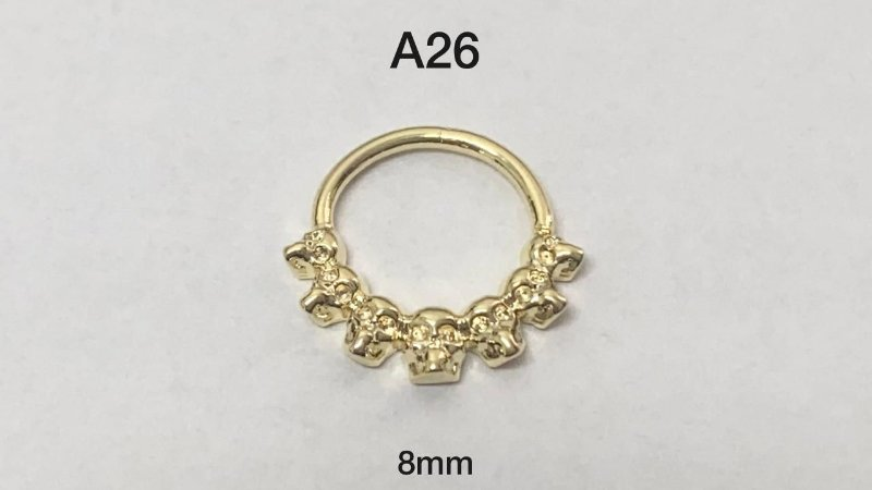 Argola torção folheado dourado caveira 8mm