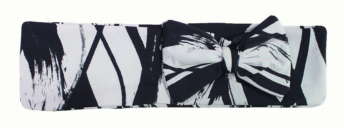 Faixa com laço preto e branco