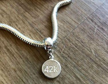 Berloque 42k em prata 925