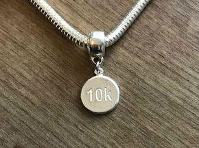 Berloque 10k em prata 925