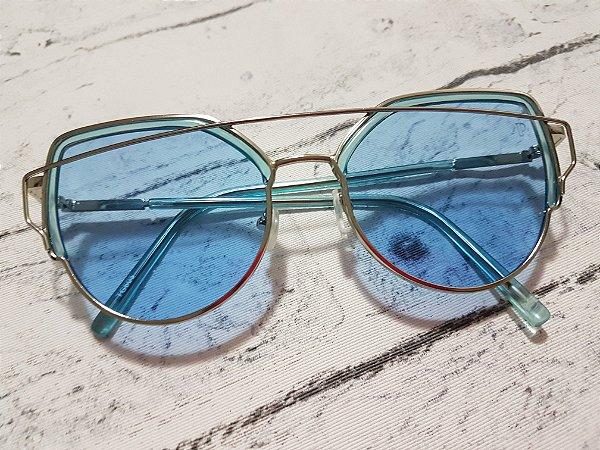 Óculos azul da cor do mar