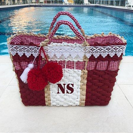 Bolsa de palha vermelha e branca
