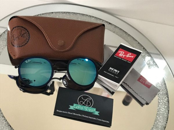 Óculos de Sol Ray Ban Round Armação Preta Lente Azul Espelhado RB 3518