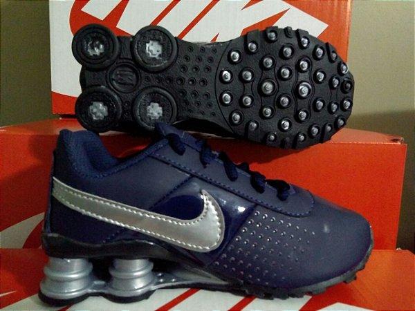 6c23d2eb314 ... Tênis Nike Shox Infantil PretoDourado e AzulPrata Frete Grátis ...