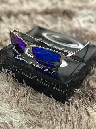 8bdeac3cd Óculos Oakley Tincan Lente Azul Armação Prata Frete Grátis - Outlet ...