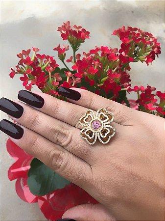 Anel em formato de flor , cravejado na micro zircônia branca com miolo rose , banhado em ouro 18, garantia no banho , TAMANHO 20