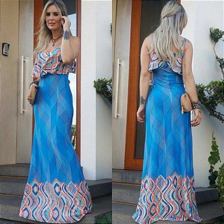 Vestido longo estampado com cor predominante azul . A cara do verão