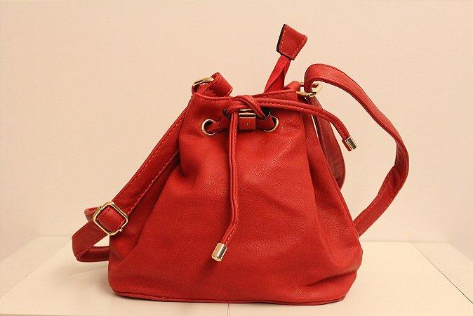 Baby bag saquinho em couro eco na cor vermelha