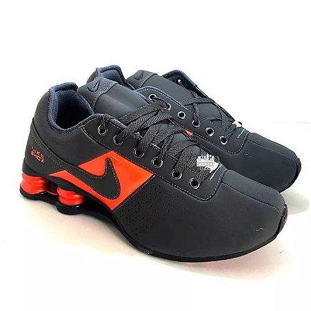 643b1d2efe7 ... uk tênis nike shox deliver classic 4 molas masculino cinza laranja  124ac a31b2 ...