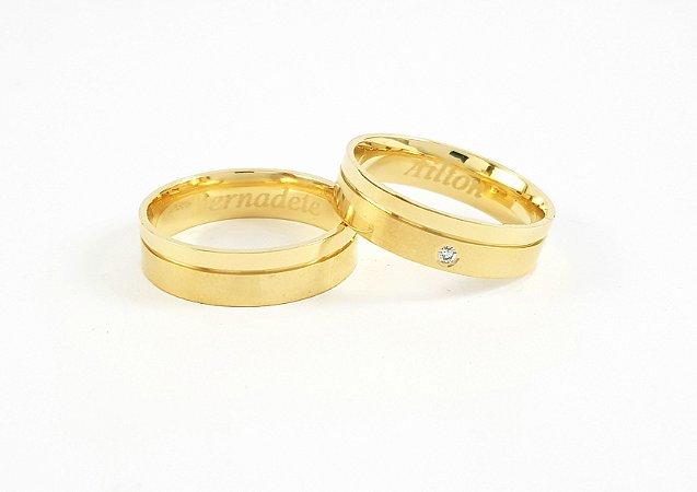 Par de alianças em ouro 18k com diamante.