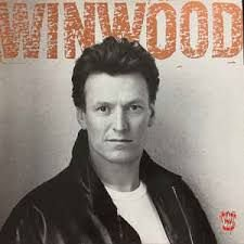 Steve Winwood ‎– Roll With It