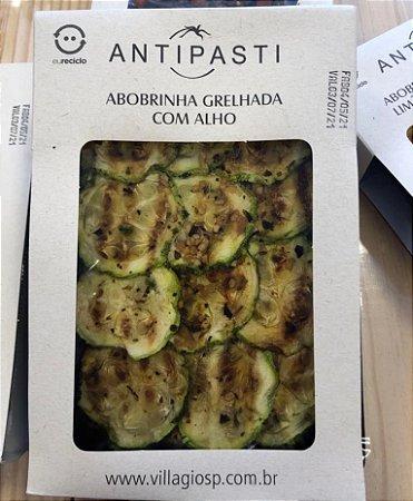 Antepasto de abobrinhas grelhadas com alho, ideal para comer como entradinha com pãezinhos e torradinhas. Peso 250g