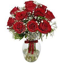 arranjo de rosas no vaso de vidro.