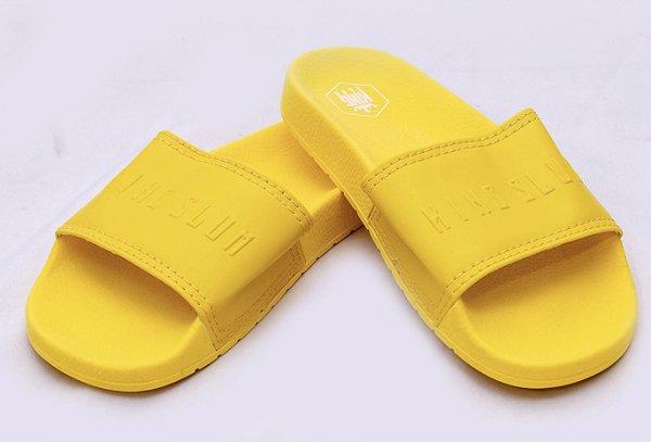 Chinelo slide amarelo
