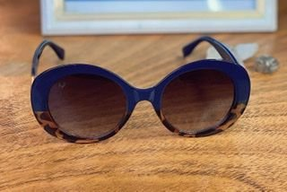 Óculos bicolor azul e animal print