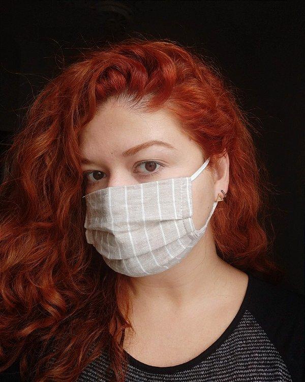 Máscara de tecido listrada bege