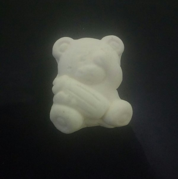 Bala de coco de ursinho dormindo com mamadeira