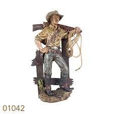 COWBOY COM CARABINA RESINA 87 x 51 x 27 cm
