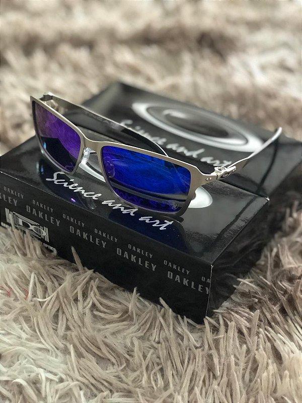 Óculos Oakley Tincan Lente Azul Armação Prata Frete Grátis