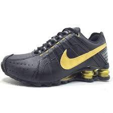 92f45434197 Tênis Nike Shox Junior - PRETO COM DOURADO