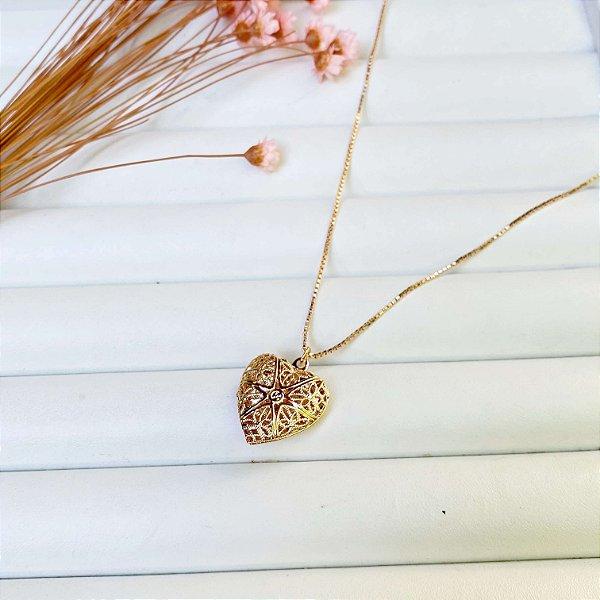 Relicário coração dourado