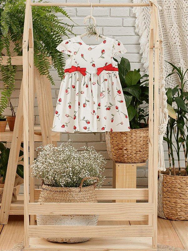 Vestido de bebê Petit Cherie algodão orgânico rosas vermelhas