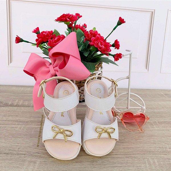 Sandália infantil Xuá Xuá lacinho dourado em couro branca