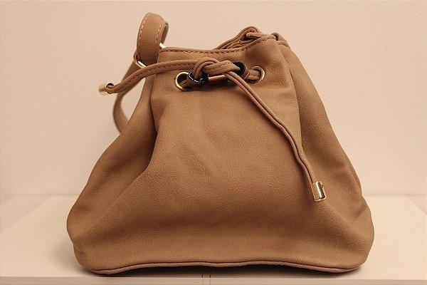 Baby bag saquinho em couro eco na cor nude