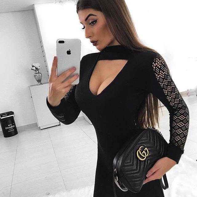 Vestido curto manga longa em renda preto