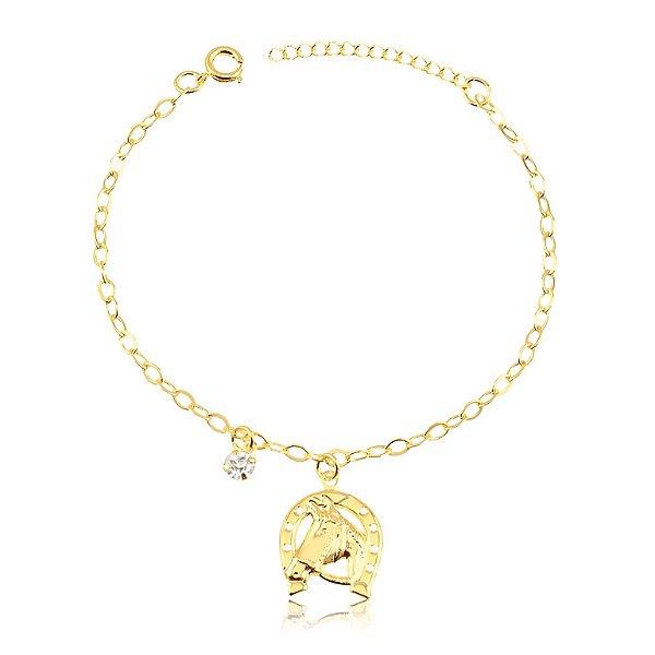 Pulseira com pingente ferradura e cara de cavalo com pedra de zircônia folheado em ouro 18