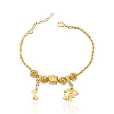 Pulseira de cachorro com berloques de osso e pata folheado em ouro 18k