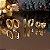 Trio de brincos de argola dourados com cravação em zircônias esmeralda - Imagem 1