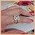 Anel Duplo Infinito em Micro Zircônia Cristal - Banho Ouro Rosé 18K - Semijoia de Luxo - Imagem 6