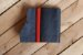 Caderno artesanal de couro preto com costura vermelha formato A6 Bodoque - Imagem 2