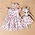 Vestido de bebê Petit Cherie natural orgânico faixa bicicleta rosa - Imagem 1