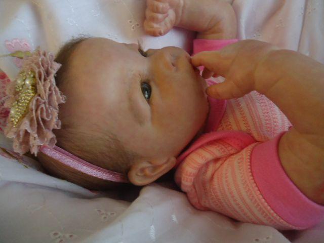Bebê reborn menina com 2 kg e 50 cm aproximadamemte