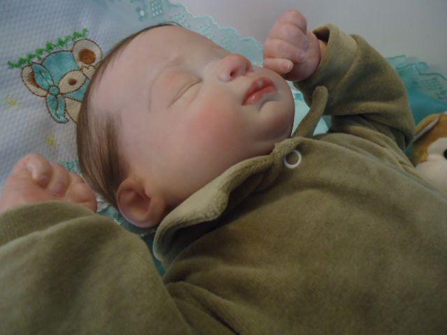 Bebê Reborn menino com 1900 g e  50 cm aproximadamente