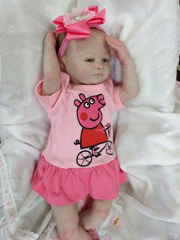 Bebê reborn menina com 2 kg e 52 cm aproximadamente