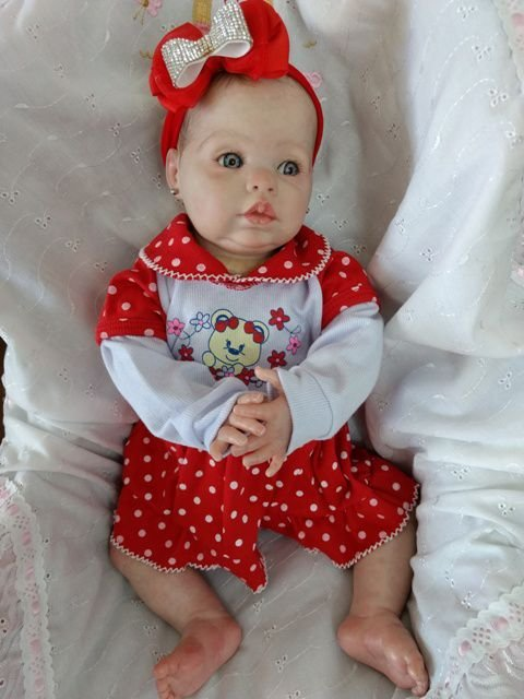 Bebê reborn menina, com 2,1 kg e 55 cm aproximadamente, kit importado, cabelos pintados, corpo em tecido